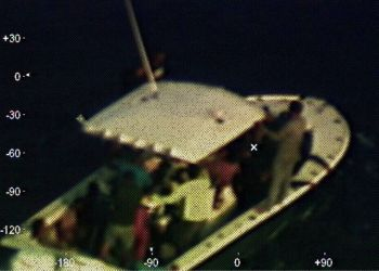 This photograph provided by the U.S. Coast Guard, captured by an airplane of that agency, shows a broken down boat located 210 kilometers (130 nautical miles) from the Yucatan Peninsula in Mexico, on Sunday, April 14, 2019. Photo: Third Class Petty Officer Brandon Giles/ U.S. Coast Guard via AP.
