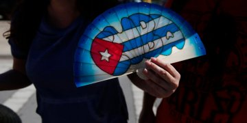 Bobbie Bryant, 41, from Orlando, holds a fan that he bought in Cuba upon his arrival to Port Everglades in Fort Lauderdale, Florida, on Wednesday, June 5, 2019. (AP Photo/Brynn Anderson)