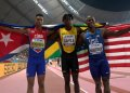 Cuban Juan Miguel Echevarría (l), bronze medalist in long jump in the Doha World Championship, Qatar, next to the new champion, the Jamaican Tajay Gayle (c) and silver medalist Jeff Henderson (r), from the United States, on September 28, 2019. Photo: Valdrin Xhemaj / EFE.