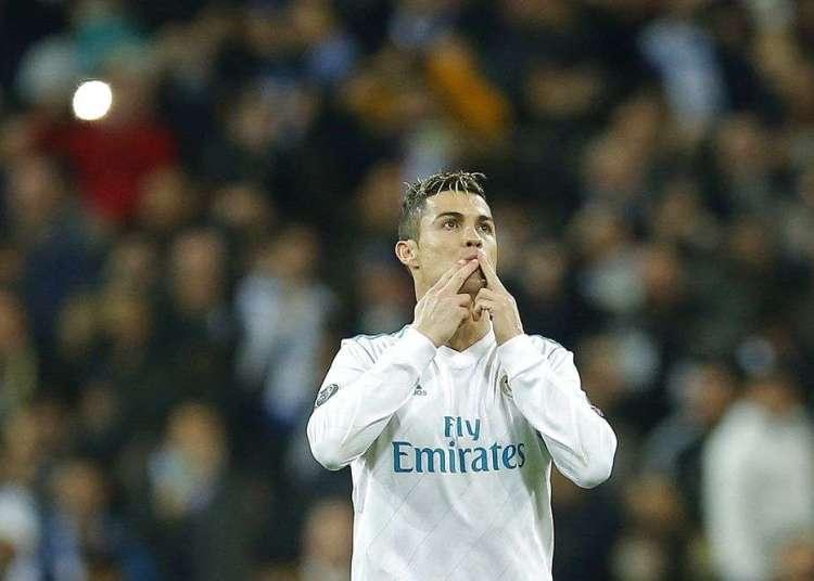 Cristiano Ronaldo, festeja tras anotar un gol contra PSG en un partido por los octavos de final de la Liga de Campeones el miércoles, 14 de febrero de 2018, en Madrid. Foto: Paul White / AP.