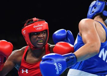 USA's Claressa Shields (left) fights against Netherlands' Nouchka Fontijn at the Rio 2016 Olympic Games.