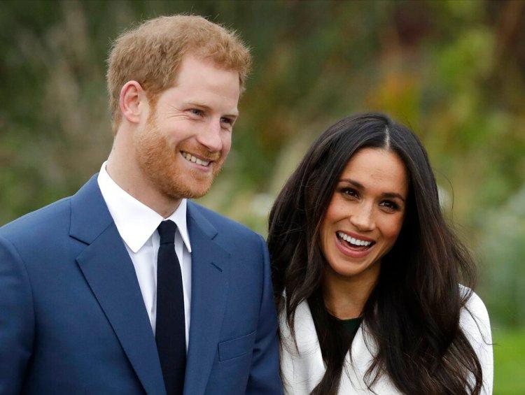 Foto de archivo del príncipe Enrique y Meghan Markle durante una sesión de fotos en el palacio de Kensington, en Londres. Foto: Matt Dunham / AP / Archivo.