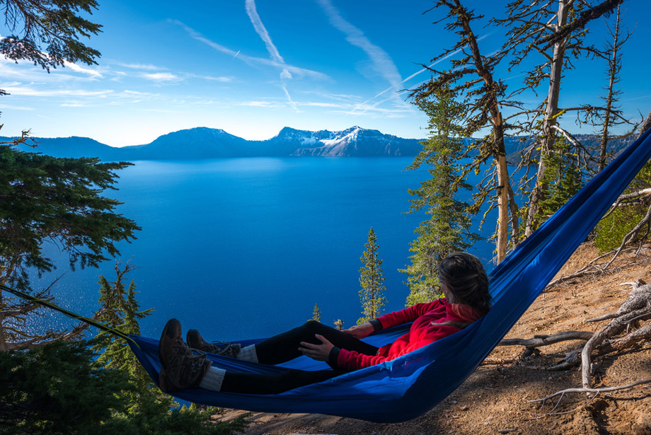 Woman Relaxes On Hammock Outdoors