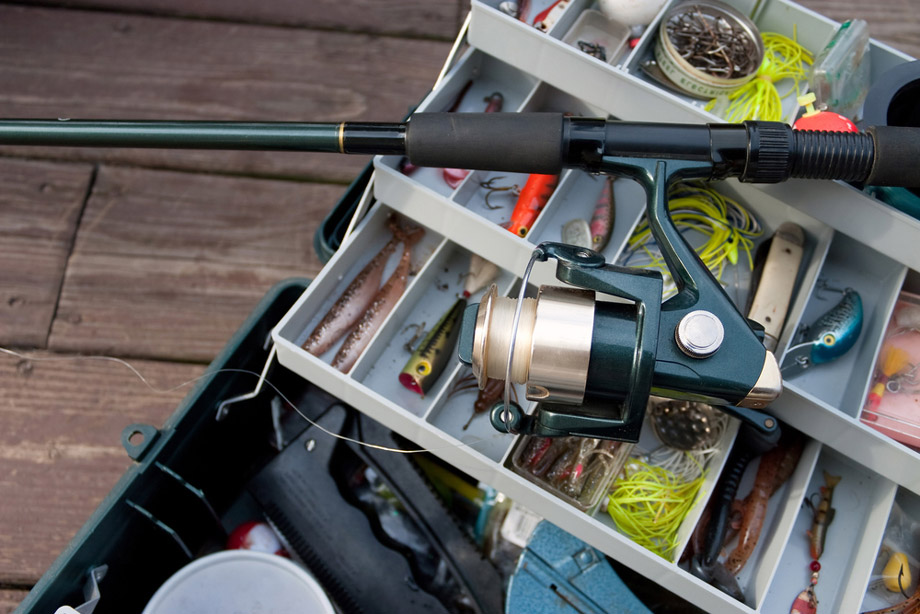 Fishing Rod And Reel Set On Full Tackle Box