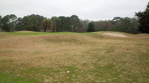 Slightly elevated greens surrounded by bunkers and abundant mounding, like those found here around the 2nd green, are hallmarks of Country Club of Hilton Head.