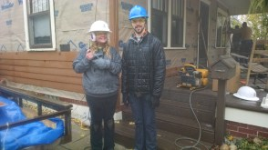 Chris Jackson and Audra Ellis in front of a house with Habitat for Humanity
