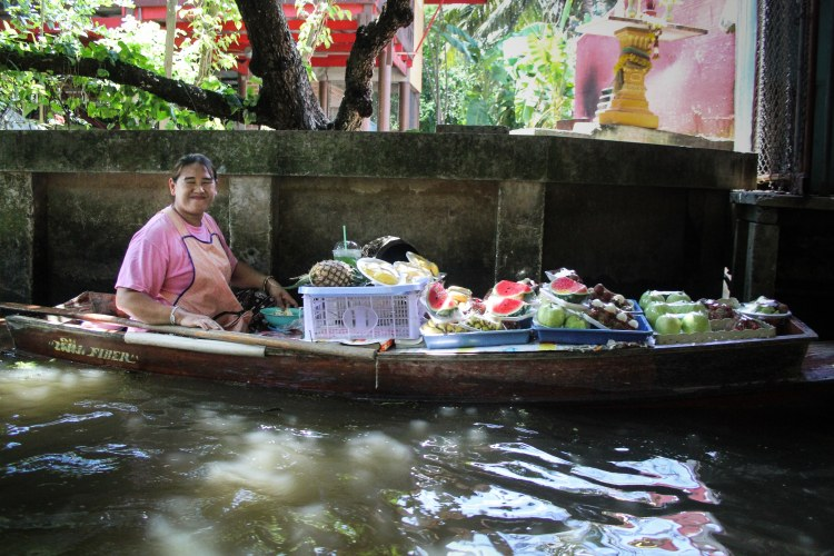woman in floating market bangkok