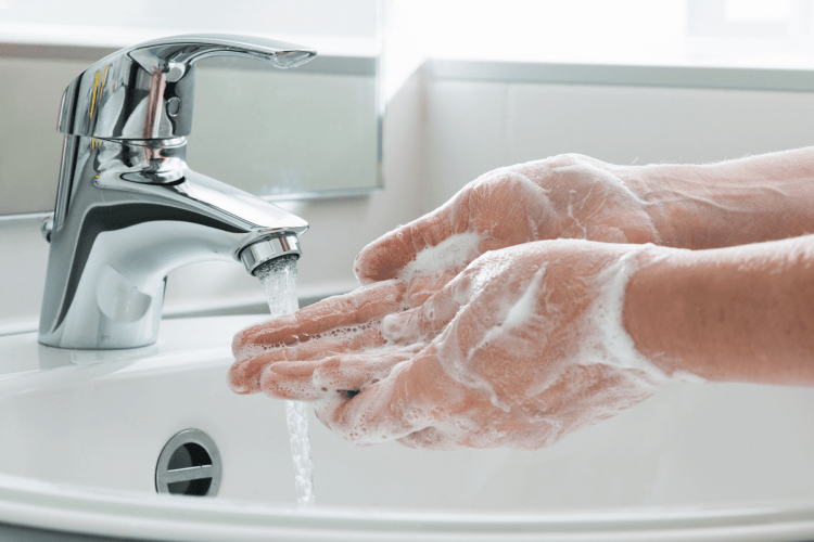 washing hands - Stay Healthy While Traveling During COVID