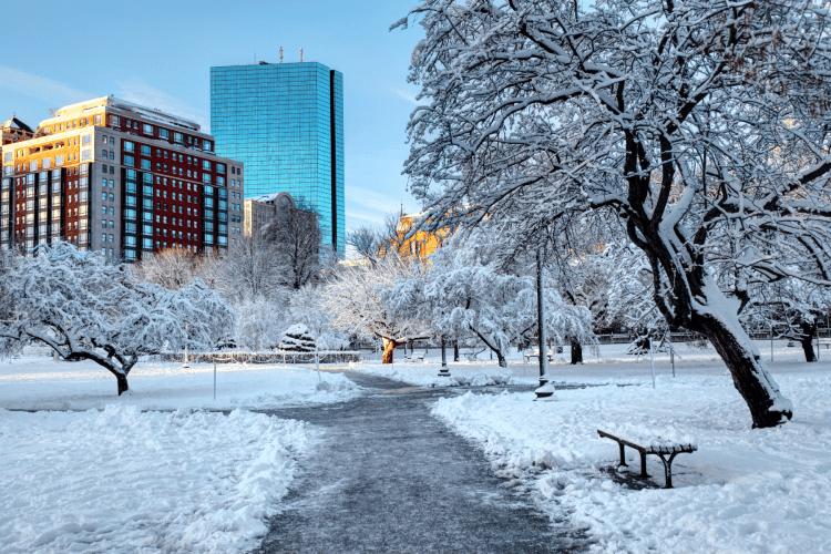 Boston Public Garden covered in snow in wintertime