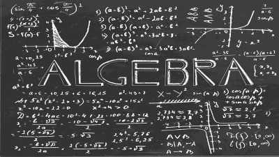 A chalkboard with equations and writing