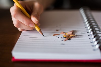 This image is of a student struggling to write.