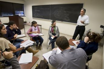 Students and professor in a smallgroup discussion.