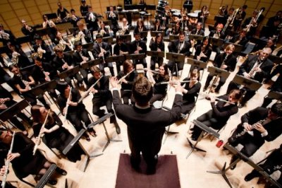 An ensemble of musicians being conducted.