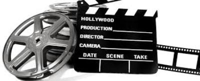 a movie director's placard and film reel