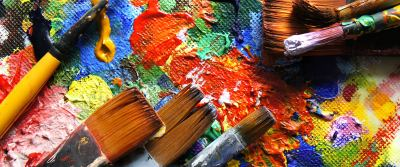 Paint brushes laying on a canvas.