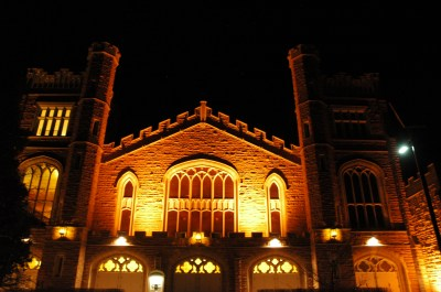 Macky Auditorium at night.