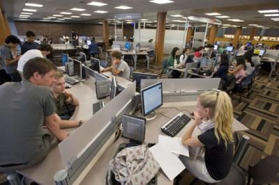 Students working at the BU Common at Mugar Library
