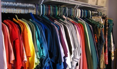 Clothes hanged in a wardrobe with hangers