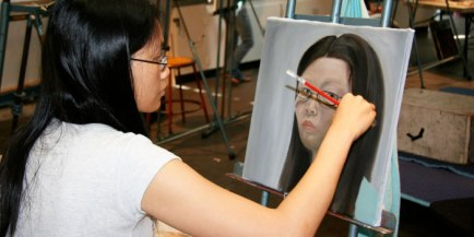 Student painting in an art class.
