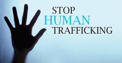 a sign advocating to stop human trafficking