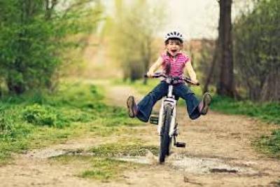 a little girl riding a bike