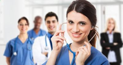 A doctor and a nurse holding a stethoscope