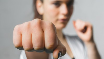 a girl making a fist