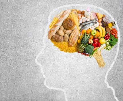 outline of person with nutritious foods in place of the brain