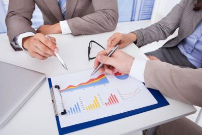Managers in an office discussing about tax