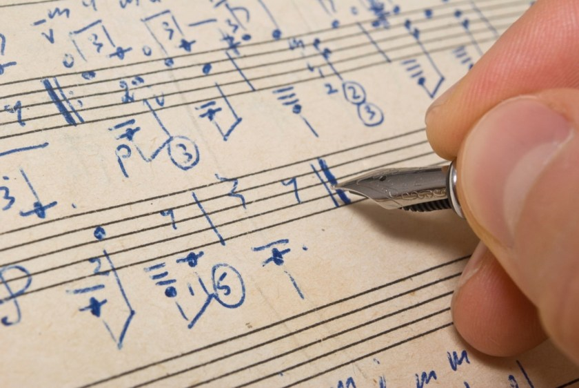A student composing music notes