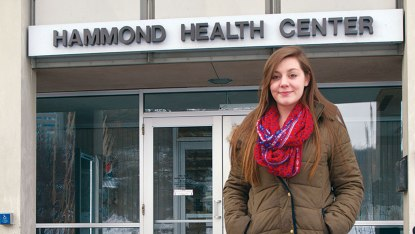 A woman standing in front of the Hammond Health Center