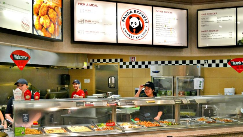 Workers at the Panda Express preparing foodstuffs for their customers