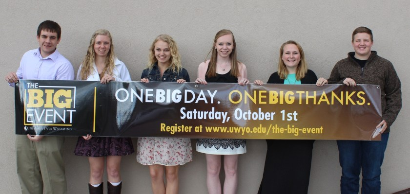 The student event executive team holding a banner about The Big Event