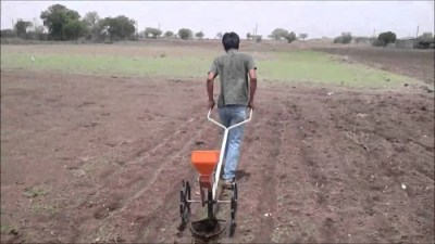 the man showing how to use agricultural equipment