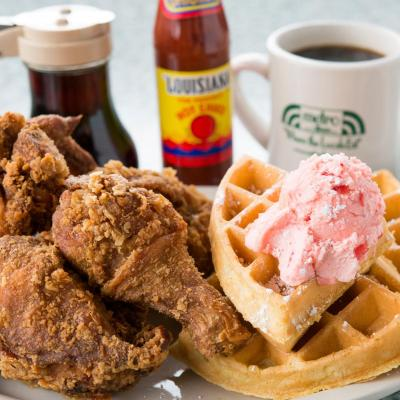 Serving of Delicious breakfast with chicken and coffee