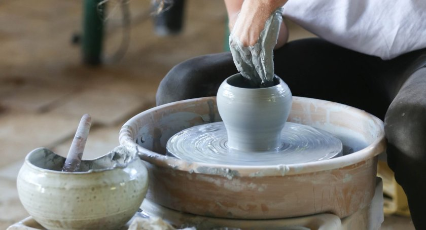 a person molding a vase