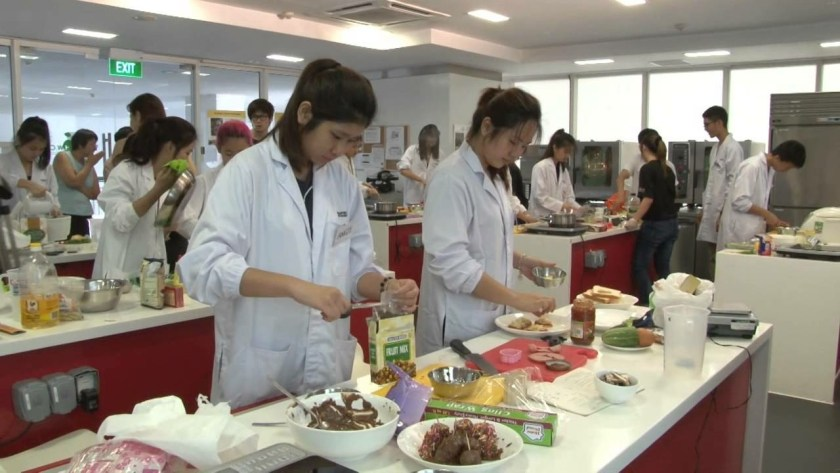 Students learning how to cook different recipes