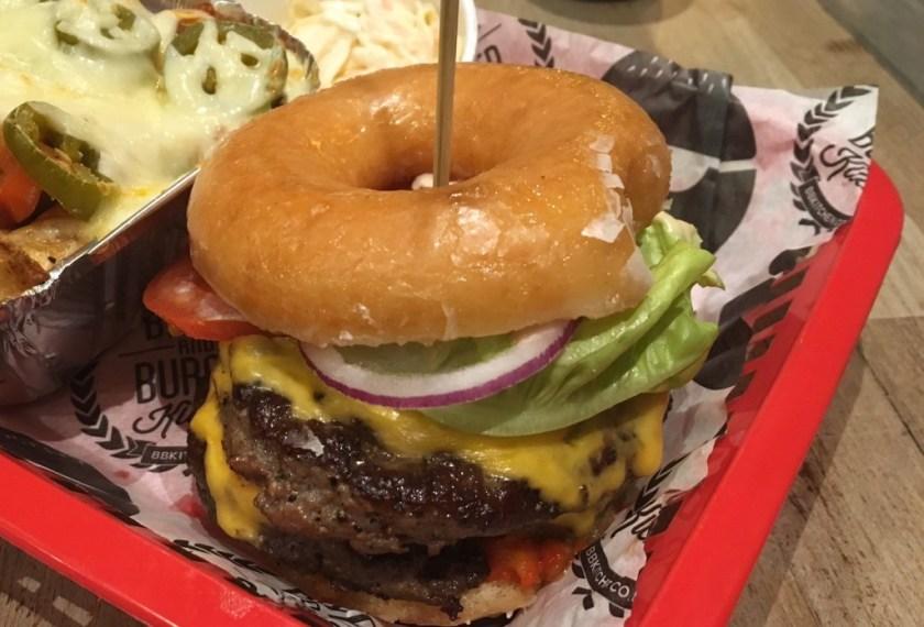 a glazed donut as the bun for a hamburger