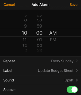 image of an alarm interface from an iphone set to repeat every sunday wit hthe label budget sheet.