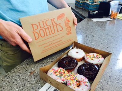six donuts with sprinkles