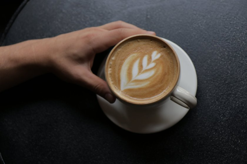 a hand with a latte