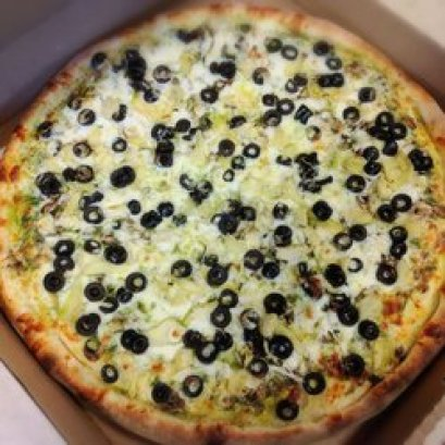 a pizza with olives