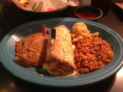a smothered burrito and rice