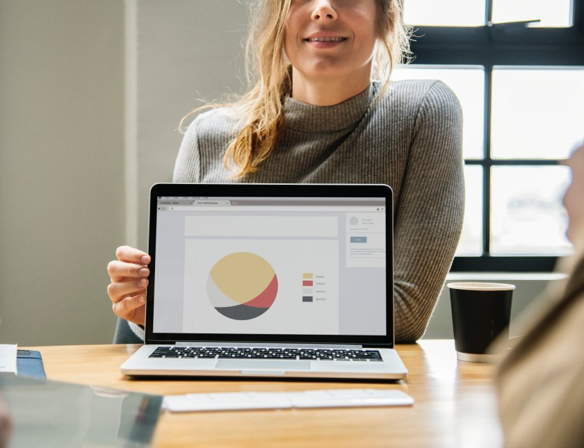 photo of a woman presenting a diagram on a laptop