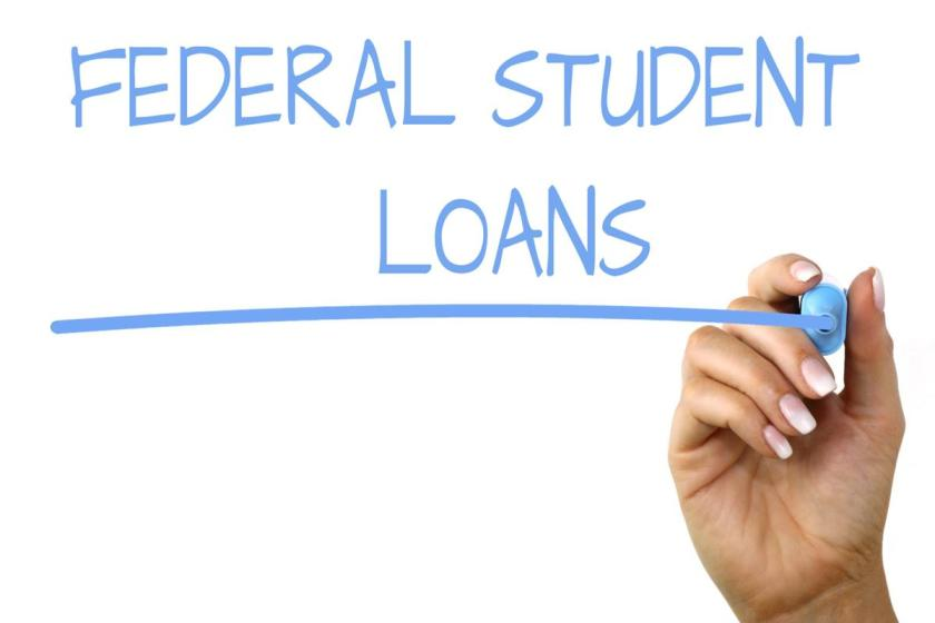 hand writing federal student loans