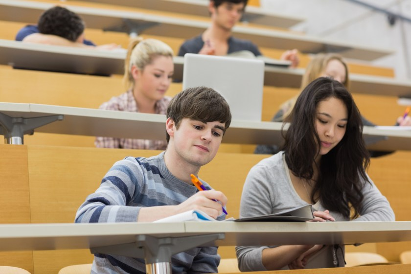 A picture of students taking notes in class.