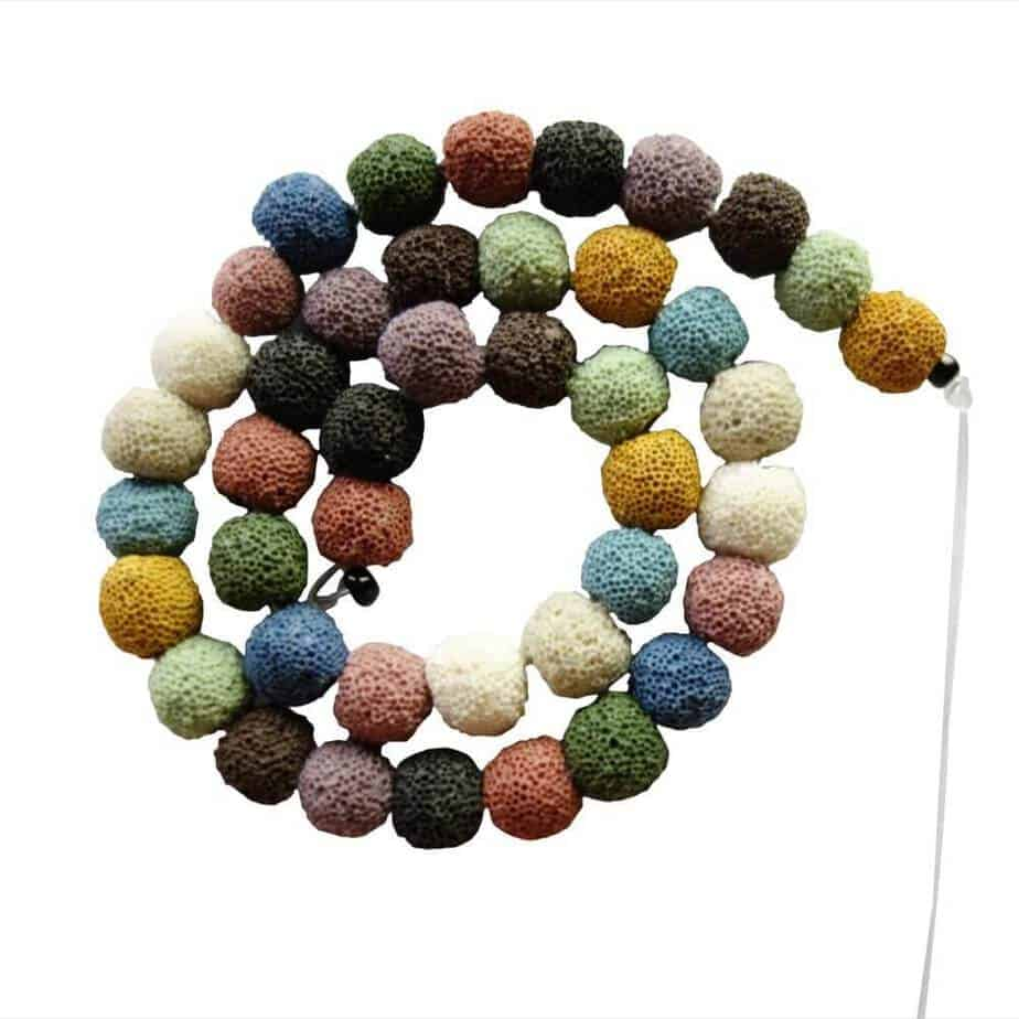 a string of colorful lava beads used to release the scent of essential oils in diffuser necklaces and bracelets