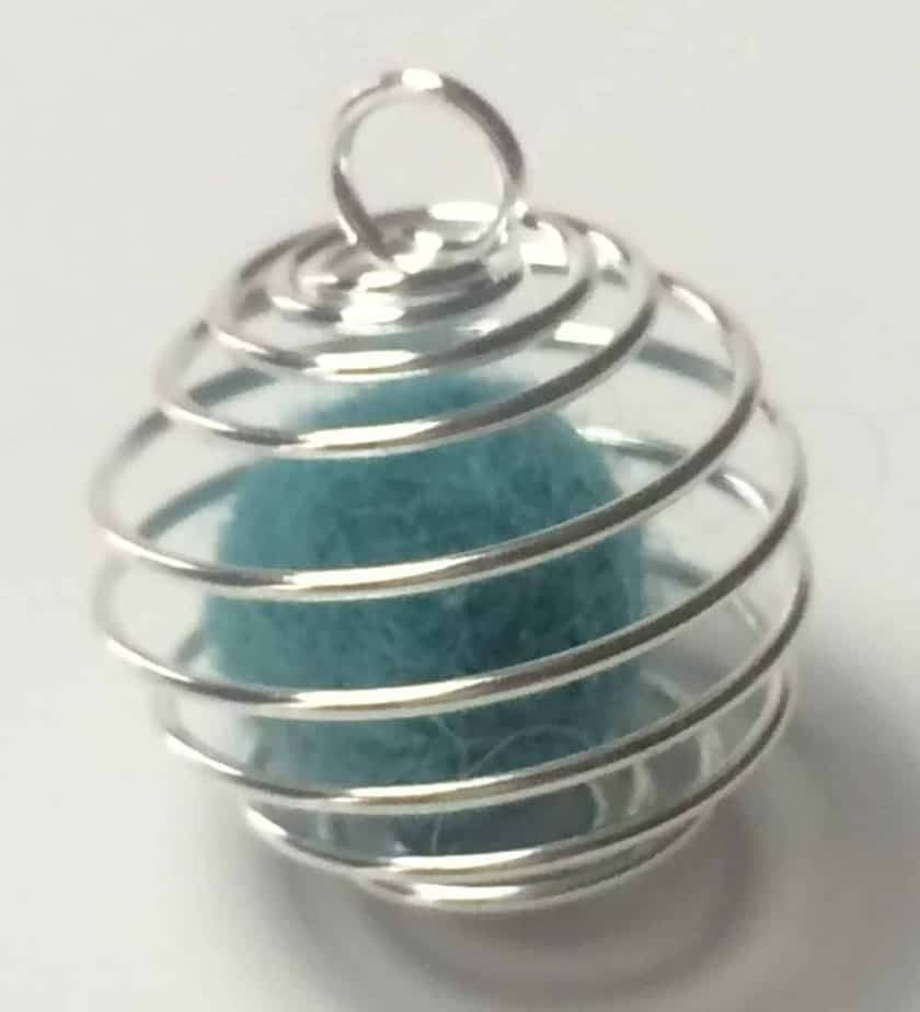 small cyan wool ball inside of silver wire cage pendant