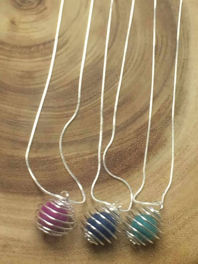 up close shot of three necklaces