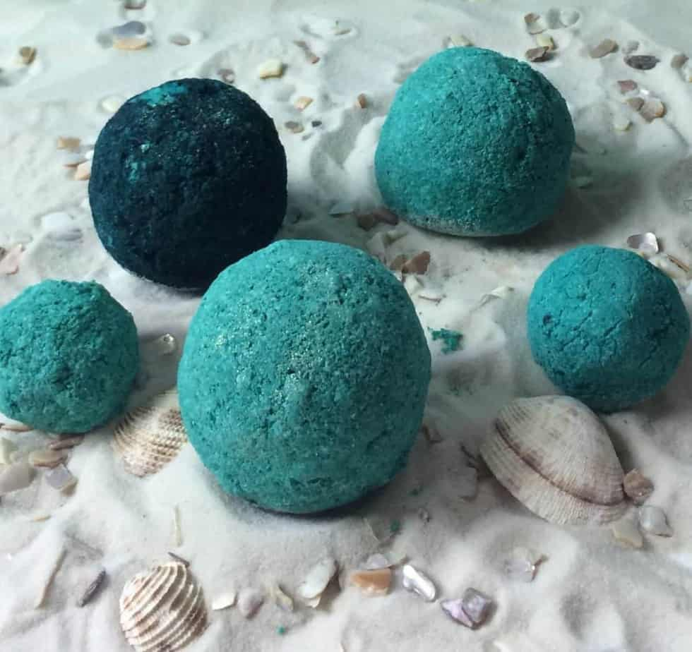 Step-by-step instructions for how to make the perfect bath bombs. So easy, even I can do it! Plus there's a FREE PRINTABLE of the bath bomb recipe and 15 essential oil blends to customize the scent and therapeutic benefits